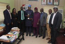 Dr. Adeniran and other Management staff with the award